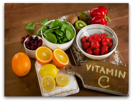 Foods containing vitamin A on a wooden background.